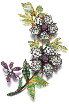 Gem set and diamond floral brooch with emeralds and rubies, late 19th century. Via Sotheby's.