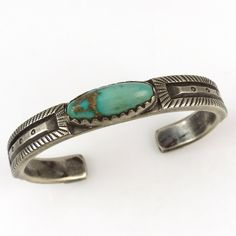 Coin Silver Cuff Bracelet with Stamped Designs and set with Natural Royston Turquoise from Nevada. Jock Favour uses traditional Navajo silversmithing techniques to create all of his pieces. He forges