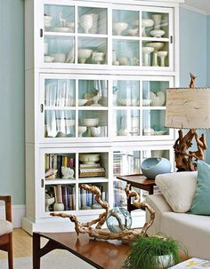 natural wood branch accents, also love cabinet with white pottery, etc.