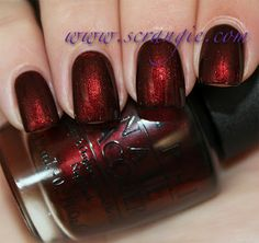 OPI German-icure by OPI. A dark, vampy, brown-tinged shimmery red. Looks velvety and shiny, not too dark, not too bright, ever so slightly metallic-shiny and even has a subtle gold shift to it.