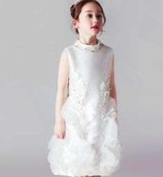 Floral Dress--Beautiful & Elegant Beaded Crystal Rhinestone High Neckline Flower Sleeveless Knee Length Embroidered Flower Applique Little Girl Party Dress. Available from 2 until 14 years old. Material: Cotton, soft polyester fiber. Color: White. Please do compare your little girl measurements with our size chart below before deciding her size or you can select the Custom Size option and we will make the dress according to your specific size.