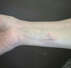 Minimalist bird tattoo