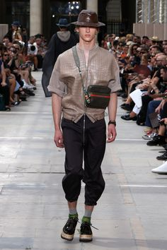 A look from the Louis Vuitton Men's Spring-Summer 2018 Fashion Show by Kim Jones, presented in the Palais Royal in Paris, France.