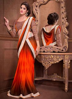 Shop this product from here.. http://www.silkmuseumsurat.in/orange-and-grey-shaded-faux-georgette-saree?filter_name=4544  Item :#4544  Color	 : Grey, Orange Fabric	 : Faux Georgette Occasion	 : Festival, Party, Reception, Wedding Style	 : Traditional Saree Work	 : Embroidered, Patch Border