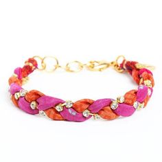 Vintage Sari Bracelet - a colorful & eco-friendly accessory. Features fabric from an authentic vintage silk sari that has been delicately hand-woven with tiny crystals to create a one-of-a-kind adornment. Wear it alone or stacked with other bangles.