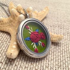 How gorgeous is this one of a kind hand embroidered locket? Floral Rose embroidery pendant necklace https://www.etsy.com/listing/251375884/embroidered-necklace-embroidery-jewelry