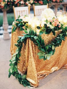 Glamorous table setting draped with greenery #weddingdecor #outdoorwedding #goldwedding #glamwedding #tablescape