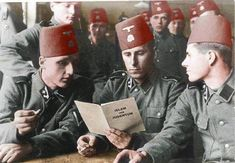 """osnian Muslim soldiers of the 13th mountain division SS Handschar (1st Croatian) reading a brochure authored by Grand Mufti of Jerusalem, Haj Amin al-Husseini titled """"Islam and Judaism"""", summer 1943. Strength of this division was 21 065 men, of which 90% were Bosnian Muslims and 10% were Croatian Catholics. With this number of men it was the largest division of the Waffen SS. The officers were mainly Germans."""