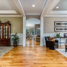 Formal living and dining rooms feature hickory hardwood flooring, wainscoting, decorative moulding, tray ceilings, crown molding, and elegant lighting. Listed in Vienna Virginia by The Casey Samson Team is a Wall Street Journal Top Team in Northern Virginia.