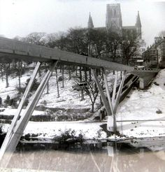 Durham University - The famous Austin 7 suspended from Kingsgate Bridge. RAG week 1964. Photo courtesy of Mike Hall (Chemistry, Grey, 1963-66)