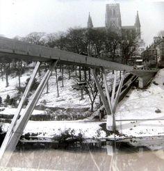 Durham University - The famous Austin 7 suspended from Kingsgate Bridge. RAG week 1964. Photo courtesy of Mike Hall (Chemistry, Grey, 1963-66)