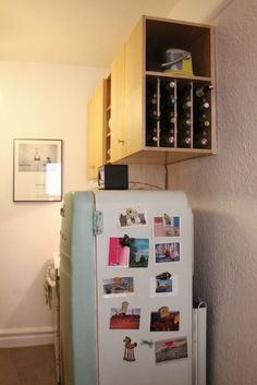 Wine bottles in cabinet above fridge!  I like!