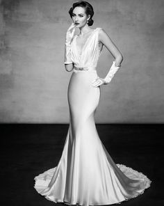 Lusan Mandongus - Hong Kong - A very sexy mermaid wedding dress with plunging neckline adorned with romantic lace details.