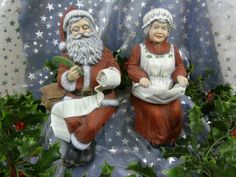 mr. and ms. Santa Claus voor op de plank
