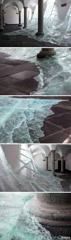 """German artist Baptiste Debombourg new """"Aerial"""" - with shards of glass art creation of flooding"""