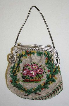 Purse  Date:     19th century Culture:     French Medium:     glass, silk, metal Dimensions:     Length: 4 in. (10.2 cm) Credit Line:     Gift of Mr. Louis Coblentz, 1958