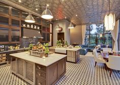 The kitchen has a unique tin ceiling, two islands, and a breakfast nook. Jeremey Remmer's house