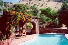 Hartbeespoort Self catering, nestled nearly invisibly into beautiful hills bordering Cradle of Humankind, Hideaway at the Farm with it's endless views of the Hartbeespoort Dam and the Magalies Mountains, provides for the relaxed vacation base to restore your soul and the start of your African adventure.