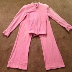 Pink comfy velour sweatsuit outfit! Very comfy, fashionable, colorful sweatsuit outfit. Love this outfit. Comes with zippered sweatshirt & sweatpants! Both size small. The left side of sleeve got some bleach on it but it blends in well. Kinda looks like I bought it that way. Other than that the suit is perfect condition. It's warm. Bundle to save on shipping. NO trades, sorry! Instant Action Pants Jumpsuits & Rompers