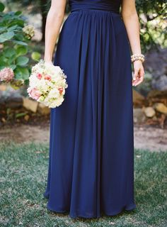 Formal elegant real wedding with navy blue bridesmaids. Michael Radford Photography.