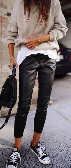gray sweater, white top, black latex pants, and low-top sneakers outfit