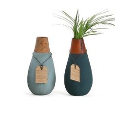 """These """"green"""" vases are handmade in Sri Lanka from recycled paper and sand and are 100% waterproof. The wooden neck is made out of mahogany offcuts from the furniture industry."""