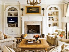arched built-in bookcases flanking traditional mantel
