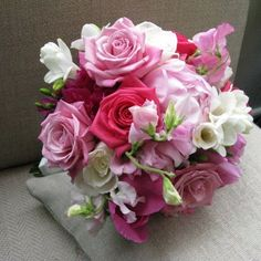 Pink! Roses, peonies, freesia, and sweetpeas make this bouquet especially frilly and feminine.