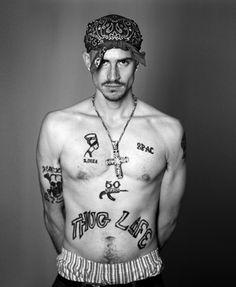 Tattooed thug named maddock abusing himself