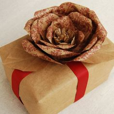Paper flower made out of a grocery bag. This project costs almost nothing to make but looks great!