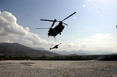 A U.S. Army CH-47 Chinnok helicopter delivers two 105 mm Howitzers at Forward Operating Base Fortress, located in the Nangahar Province of Afghanistan, April 8, 2008, during Operation Enduring Freedom