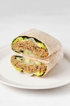 These lentil tahini wraps are a simple, tasty, and nourishing plant-based lunch! Made with vegetables and legumes, they're easy to customize. Wrap Recipes, Vegetable Recipes, Veggie Meals, Vegetarian Meals, Dinner Recipes, Hummus Sandwich, Sandwich Spread, Vegan Burgers, Wrap Sandwiches