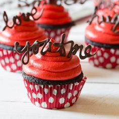 Dark and decadent Chocolate Cupcakes with creamy Red Velvet Frosting! Tutorial on how to make chocolate word toppers.