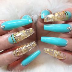 Beautiful coffin nails using a bright teal with a combination of gold striping tape, gold flakes and rhinestones by @nailcotics Ugly Duckling Nails page is dedicated to promoting quality, inspirational nails created by International Nail Artists