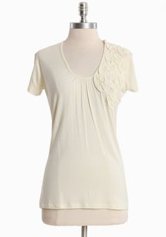 """Love Bouquet Tee 32.99 at shopruche.com. Delicate floral appliques add artistry and texture to this soft cream tee with the perfect hint of sheen. Polished with a scoop neck, cap sleeves, and a touch of stretch.  95% Rayon, 5% Spandex, Imported, 26.5"""" length from top of shoulder"""