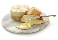 Made in a tiny town in the Burgundy region of France, Epoisses is one of the great cheeses of the world. It is a name-controlled cheese that has a very pungent Milk And Cheese, Creamy Cheese, Soft French Cheese, Cheese Online, Best Cheese, How To Make Cheese, Food Items, Gourmet Recipes, Kitchens