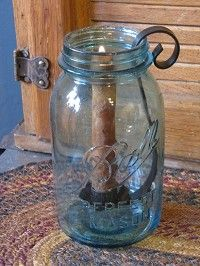 This Antique Ball Mason Jar with Black Taper Candle Holder would look great on a mantle, end table, or bench!  http://www.primitivestarquiltshop.com/Antique-Ball-Mason-Jar-with-Black-Taper-Candle-Holder_p_6457.html  $13.95