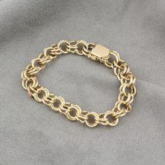 Pre-Owned 14 Karat Yellow Gold Charm Bracelet  $1,195.00