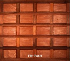 A wooden garage door in Flat Panel style.