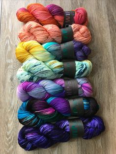 Rainbow yarn love! Left to right: Out of This World, Midnight in the Garden, I'm Your Venus, You Mean the World, Iris, Peachy Keen, and Love's Orbit by WIPyarns