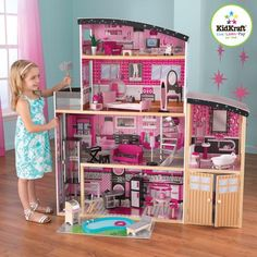 The Kidkraft Sparkle Mansion wooden Dollhouse has 4 levels, swimming pool, an elevator, and 30 furniture pcs and accessories. The Kidkraft Sparkle Mansion Dollhouse accommodates all fashion dolls up to tall, including Barbie and Bratz. Wooden Dollhouse, Dollhouse Dolls, Dollhouse Miniatures, Wooden Dolls, Doll Furniture, Dollhouse Furniture, Wooden Furniture, Mattel Barbie, Barbie Dolls