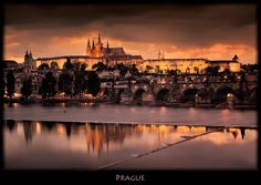 https://flic.kr/p/6XRKSD | Prague | Rework of a very similar shot I posted a while back. This is such a beautiful scene that it is fun to tinker in PS to acheive different looks.   The Shot: - ISO 100, 30mm, f11, 8 sec.  Processing: - Neutralized the strong blue cast using a graduated coffee filter onthe top and bottom. - Converted to BW using Nik Color Efex, and used the U controls to let some color shine through. - Dodge and burn to accent bridge and reflections.