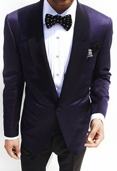 Classic blue suit and polka dot bow tie.