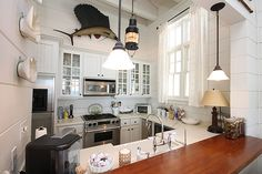 old beach cottage style kitchen with painted plank walls