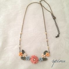 crochet flower necklace - don't expect to crochet tiny flowers, but this would work with pieces of old jewelry
