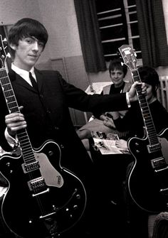 That Eventuality/tumblr: George displaying both of his Gretsch Country Gentleman guitars.  Photo: Popperfoto/Getty Images