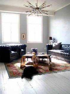 love the leather couch paired with traditional rug. I would obviously hang a few things on the wall though!