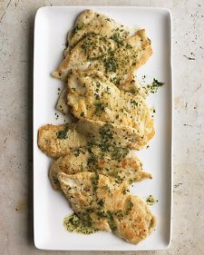 1/4 cup all-purpose flour 8 thin chicken cutlets (1 1/2 pounds total) Coarse salt and ground pepper 2 tablespoons olive oil 3/4 cup dry white wine 2 tablespoons cold butter, cut into pieces 3 tablespoons finely chopped fresh parsley or mint (or a combination)