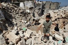 A boy walked in the rubble of Syrias Salqin city on Tuesday after a missile attack.