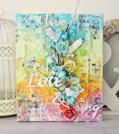 Hi readers! Happy Wednesday to you! I fell in LOVE with this gorgeous canvas creation by Stacey Young when I came across it! The texture, colors, etc. GUSH. Fabulous!! Of course, this had to go on our